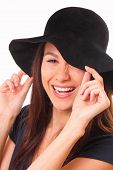 Charming And Happy Young Woman In A Black Hat