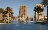 stock photo of qatar  - Fountain at The Pearl Porto Arabia Doha Qatar - JPG