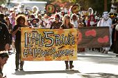 Women Carry Banner That Starts Halloween Parade
