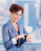 Closeup portrait of businesswoman waiting for someone, attractive female wearing elegant suit on cit