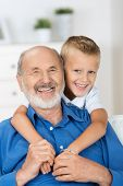 Happy Young Boy With His Grandfather