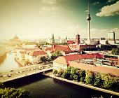 Berlin, Germany rooftop view on Television Tower, Berlin Cathedral, Rotes Rathau and the River Spree. Major landmarks retro, vintage style.