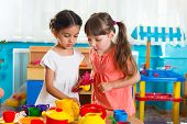 picture of daycare  - Two cute little girls playing role game in daycare - JPG