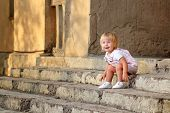 Girl Sitting On The Steps Of The Porch