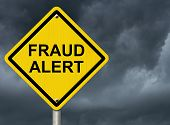 picture of precaution  - A road warning sign against a stormy sky with words Fraud Alert Warning of Fraud - JPG