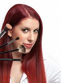 Beauty close-up woman with makeup brushes near her face