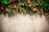 pic of xmas tree  - vintage christmas decoration over old wooden background - JPG