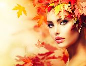 Autumn Woman Portrait. Beauty Fashion Model Girl with Autumnal Make up and Hair style. Fall. Creativ