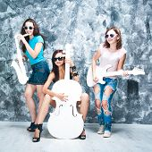 stock photo of cello  - female rock band - JPG