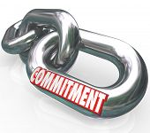 The word Commitment on chain links locked together to illustrate dedication, determination, promise,