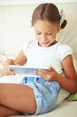 Child playing on tablet pc at home