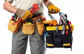 stock photo of labor  - Handyman with a tool belt - JPG