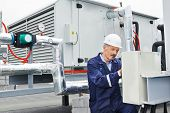 stock photo of hvac  - senior adult ventilation electrician builder engineer at work - JPG
