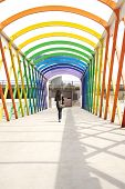 Walking At Colorful Footbridge