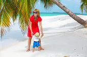 Mom And Baby Having Tropical Vacation