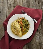 Lemon Chicken With Vegetables On A Wooden Surface
