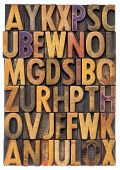 random letters of alphabet - vintage letterpress wood type printing blocks scratched and stained by color inks
