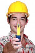A handyman handing a meter.