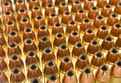 stock photo of hollow point  - handgun cartridges that are loaded with hollow point bullets