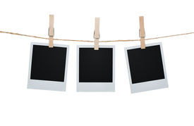 pic of clotheslines  - Blank photos hanging on a clothesline isolated on white background with clipping path for the inside of the frames - JPG