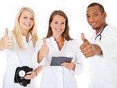 Medical team showing thumbs up. All on white background.