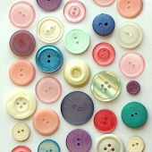 Pastel Colored Vintage Buttons On White Background