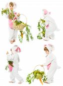 stock photo of bunny costume  - baby in easter bunny costume with fresh carrot bascet kid girl as hare rabbit over white background - JPG