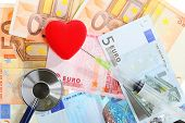 Cost Of Health Care: Stethoscope Red Heart On Euro Money