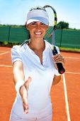 smiling female tennis player giving hand for handshake, fair player
