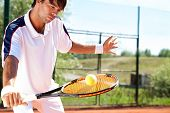 tennis player holding racket with ball