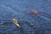 Long Beach Junior Crew(L) and the Windsor School (r) race in the Head of Charles Regatta on October