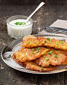Fried potato pancakes on the old wooden background