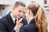 image of politeness  - Young businessman greet polite his partner with kissing hand