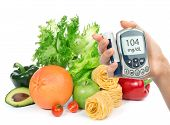 Glucose Level Blood Test Meter In Hand And Healthy Organic Food Fruits And Vegetables