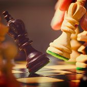 playing wooden chess pieces , warm colors toned
