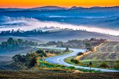 Tuscany foggy landscape at sunrise, Italy