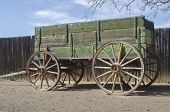 stock photo of wagon  - Antique wild west Pioneer wagon with noise and grunge texturing - JPG