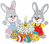 stock photo of fancy cakes  - Little bunnies celebrating Easter with a fancy holiday cake and colorfully painted eggs - JPG