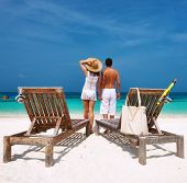 Couple in white on a tropical beach at Maldives