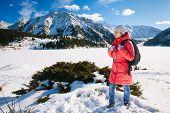 Young Woman Take A Walk On Winter Mountain Slope (big Almaty Lake, Kazakhstan)