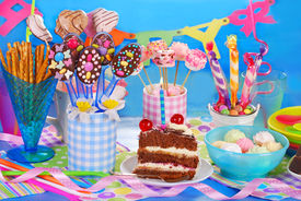 image of torte  - colorful birthday party table with chocolate torte and homemade sweets for kids on blue background - JPG