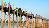 MANDALAY, MYANMAR - JAN 19, 2014: Unidentified group of tourists visiting U Bein bridge. U-Bein bridge is very famous Burmese landmark