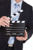 Businessman Holding Clapboard