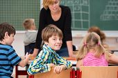 Young Boy In Class Turning To Smile At The Camera
