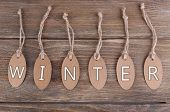 Winter tags on wooden background