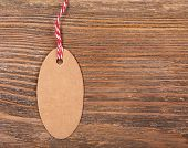 empty tag on brown wooden background