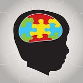 stock photo of aspergers  - A silhouette of a child with symbolic autism puzzle pieces making the brain space - JPG