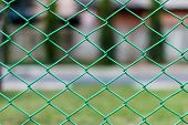 Green Steel Wire Chain Link Net Fence Photo Stock With Garden Background