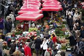 ZAGREB, CROATIA - DECEMBER 03: Unidentified people sell flowers at Dolac Market on December 03, 2011