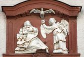 MILTENBERG, GERMANY - 20 JULY: The Annunciation, bas relief on the main street of Miltenberg, Lower Franconia, Bavaria, Germany, on July 20, 2013